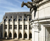 Abbey patio. With gargoyles on the building Stock Photo
