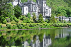 The Abbey. Reflecting in a pond the surrounding area lush with greenery royalty free stock images