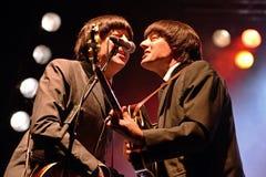 Abbey Road (musikbandhedersgåva till Beatleset) utför på den guld- nypremiärfestivalen Arkivbilder