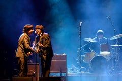 Abbey Road (tributo da faixa ao Beatles) executa no festival dourado do renascimento Fotos de Stock Royalty Free
