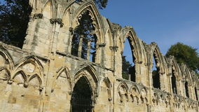Abbey Ruins - City of York - England. Ruins of St Mary's Abbey, a ruined Benedictine abbey that dates from 1055AD. In York Museum Gardens in the city of York in stock footage