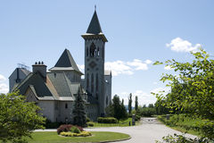 Abbey Saint-Benoit-du-lac, Quebec. Saint-Benoit-du-Lac Abbey (home to Benedictine monks) is located on the west shore of Lake Memphremagog in the Eastern stock images