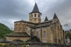 Abbey of Saint-Foy at Conques. Conques, Midi Pyrenees, France - June 12, 2015:View to Abbey of Saint-Foy at Conques, France stock photography
