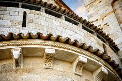 Abbey of Sant`Antimo in Montalcino.Exterior, particular ornament apse..  Tuscany, Italy. The abbey of Sant`Antimo is a monastic complex in Olive located near Stock Photography