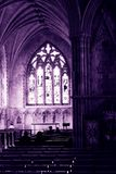 Sacred. My inner peace and the colour of my soul. Abbey, St Albans, United Kingdom. Marvelous windows reflecting their light on the sacred space. People praying stock photography