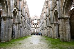 Abbey of St. Galgano, Tuscany. View of a the abandoned Cistercian abbey of San Galgano, one of the most beautiful spots in Tuscany Stock Image