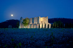 Abbey of St. Galgano under the moonlight Tuscany. View of a the abandoned abbey of San Galgano, one of the most beautiful spots in Tuscany under the moonlight Royalty Free Stock Image