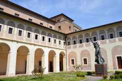 Abbey of St Scholastica, Subiaco. The graceful statue of St Scholastica in the courtyard of the abbey that bears her name in Subiaco, Italy. Photo taken April Royalty Free Stock Photography