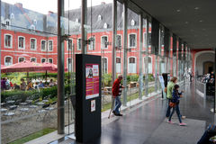 Abbey of Stavelot. STAVELOT, BELGIUM - JULY 2015: Tourist Information point in a glass corridor of the Stavelot Abbey royalty free stock photos