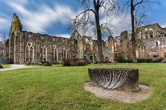 Abbeye of Villers-la-ville. Ruine of the abandoned Villers-la-ville abbey under a windy blue sky, Belgium Stock Photography