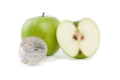 Abbildung der Äpfel und des Maßbandes Stockbilder