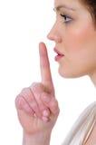 Abbildung der jungen Frau mit dem Finger auf Lippen Lizenzfreies Stockfoto