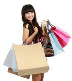 Abbildung der reizenden Frau mit Einkaufenbeuteln Lizenzfreie Stockfotografie