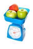 Abbildung der Skala mit Äpfeln Stockfotos