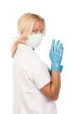 Abbildung der tragenden weißen Uniform der Krankenschwester Lizenzfreies Stockfoto