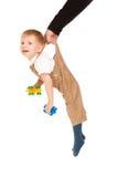 Abbildung des Kindes hängend an der Hand des Vaters Lizenzfreies Stockfoto