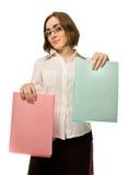 Abbildung eines Mädchens, das zwei Faltblätter demonstriert Lizenzfreies Stockfoto