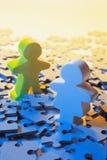 Abbildungen auf Puzzlespiel-Stücken Lizenzfreies Stockfoto