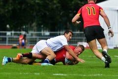 Abbini per il posto 7 Francia contro il Belgio nel rugby 7 serie del Gran Premio a Mosca Fotografie Stock