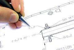 Abbozzo tecnico con la mano e la penna. Fotografie Stock