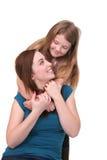 Abbracciare delle sorelle fotografie stock