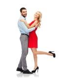 Abbracciare felice delle coppie Fotografia Stock Libera da Diritti