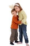Abbracciare sveglio dei bambini Immagini Stock