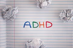 Abbreviation ADHD on notebook sheet with some crumpled paper bal Stock Photo