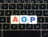 Abbreviation AOP on keyboard background. Abbreviation AOP Aspect Oriented Programming on keyboard background stock photography