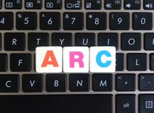 Abbreviation ARC on keyboard background. Abbreviation ARC Advanced RISC Computing on keyboard background stock photo
