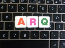 Abbreviation ARQ on keyboard background. Abbreviation ARQ Automatic Repeat Request on keyboard background royalty free stock photos