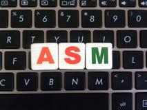 Abbreviation ASM on keyboard background. Abbreviation ASM Algorithmic State Machine on keyboard background royalty free stock images
