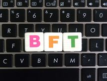 Abbreviation BFT on keyboard background. Abbreviation BFT Byzantine Fault Tolerance on keyboard background stock photo