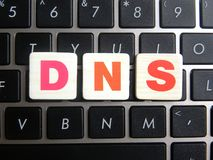 Abbreviation DNS on keyboard background. Abbreviation DNS Domain Name System on keyboard background royalty free stock images
