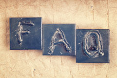 The abbreviation FAQ made from metal letters Royalty Free Stock Photos