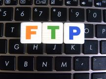 Abbreviation FTP on keyboard background. Abbreviation FTP File Transfer Protocol on keyboard background royalty free stock images