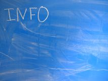 Abbreviation INFO written on a blue, relatively dirty chalkboard by chalk. Located in the upper left corner of the image making. Space for some message or note stock images