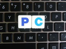 Abbreviation PC on keyboard background. Abbreviation PC Personal Computer on keyboard background royalty free stock images
