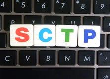 Abbreviation SCTP on keyboard background. Abbreviation SCTP Stream Control Transmission Protocol on keyboard background stock image