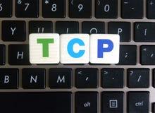 Abbreviation TCP on keyboard background. Abbreviation TCP Transmission Control Protocol on keyboard background stock photos