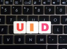 Abbreviation UID on keyboard background. Abbreviation UID Unique Identifier on keyboard background royalty free stock photography