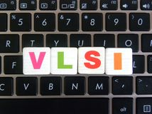 Abbreviation VLSI on keyboard background. Abbreviation VLSI Very Large Scale Integration on keyboard background royalty free stock photography