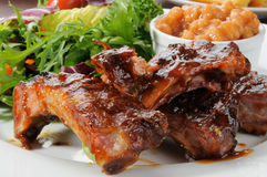 Abby back ribs and greens Royalty Free Stock Photo