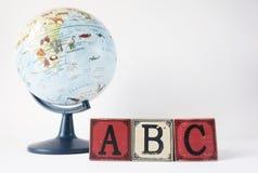 ABC和地球在白色背景 库存图片