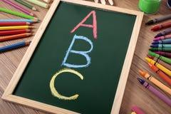 ABC学校读书文字字母表概念 免版税库存图片