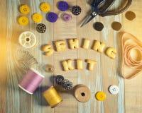 ABC曲奇饼和缝合的工具在葡萄酒木背景 免版税库存照片