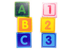 Abc 123 in toy play block letters. Toy letter and number blocks against a white background that spell abc 123 with clipping path Stock Photos