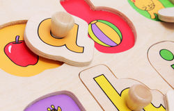Abc. Toddler jigsaw puzzle aimed at learning the alphabet Royalty Free Stock Image