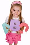 ABC. Schoolgirl holding alphabet letters, school concept royalty free stock images