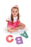 ABC. Schoolgirl with alphabet letters, school and education concept royalty free stock images